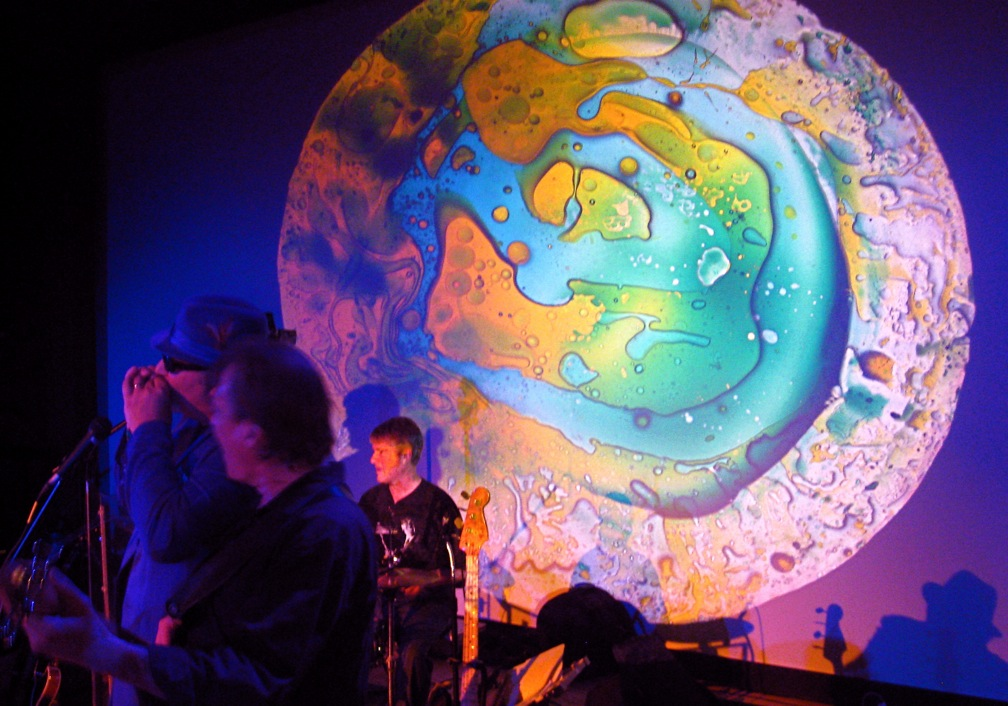 Elegant Wet Sun Light Show U2013 Liquid Projections On The Band, THE MAUMEE THEATER